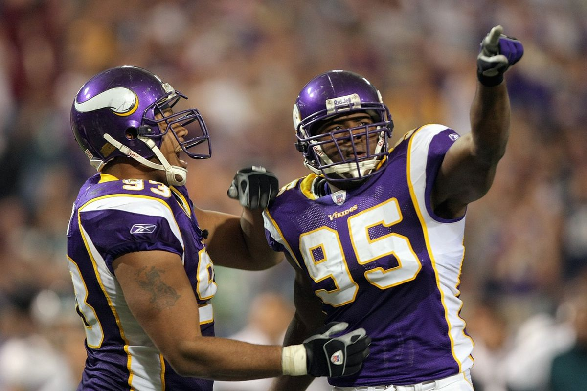 MINNEAPOLIS, MN - OCTOBER 28: Kenechi Udeze #95 of the Minnesota Vikings celebrates with Kevin Williams #93 during the game against the Philadelphia Eagles at the Hubert H. Humphrey Metrodome on October 28, 2007 in Minneapolis, Minnesota.
