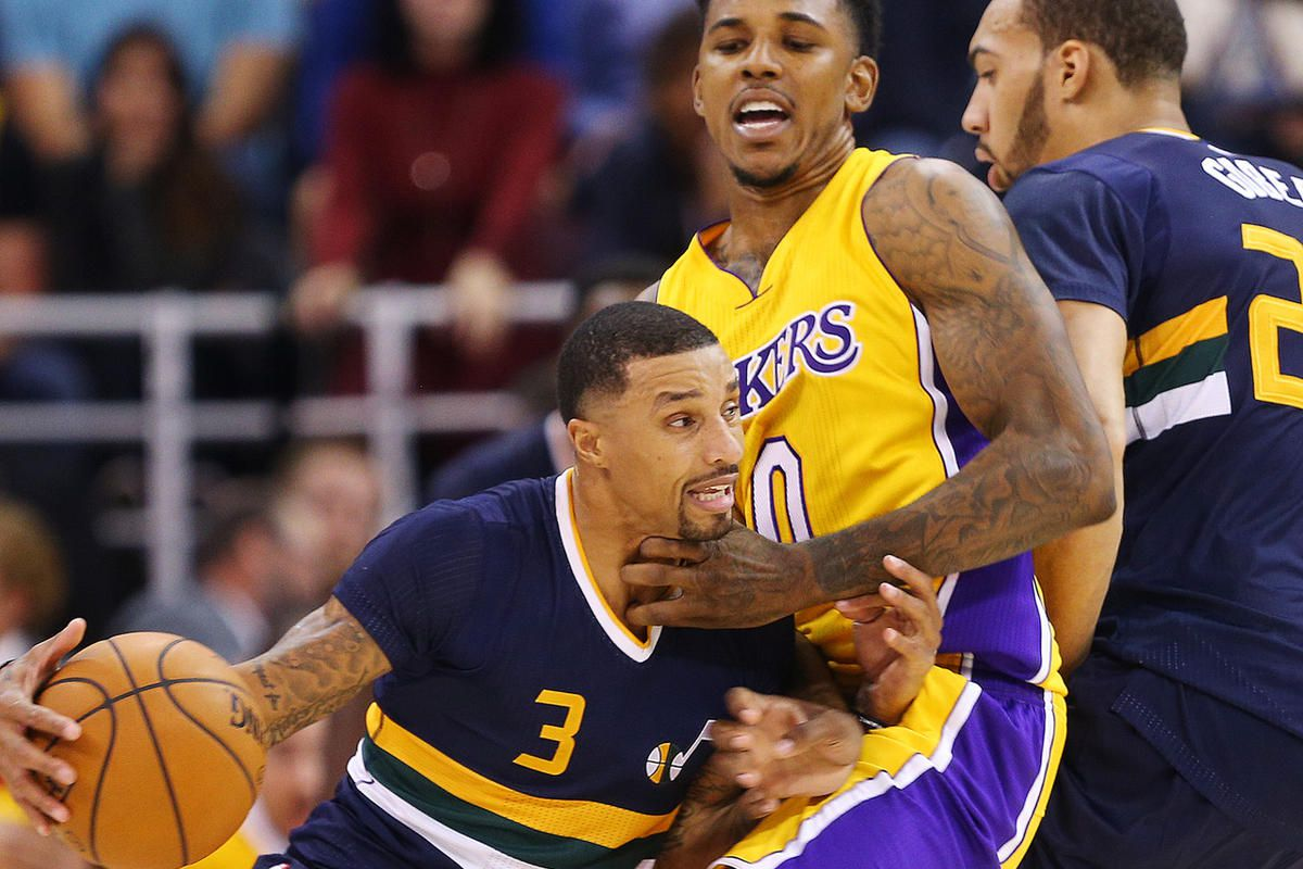 Utah Jazz guard George Hill works to get past Los Angeles Lakers forward Nick Young as the Jazz open the home season with the Los Angles Lakers in Salt Lake City on Friday, Oct. 28, 2016.