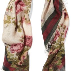 A floral printed scarf with a frayed hem.