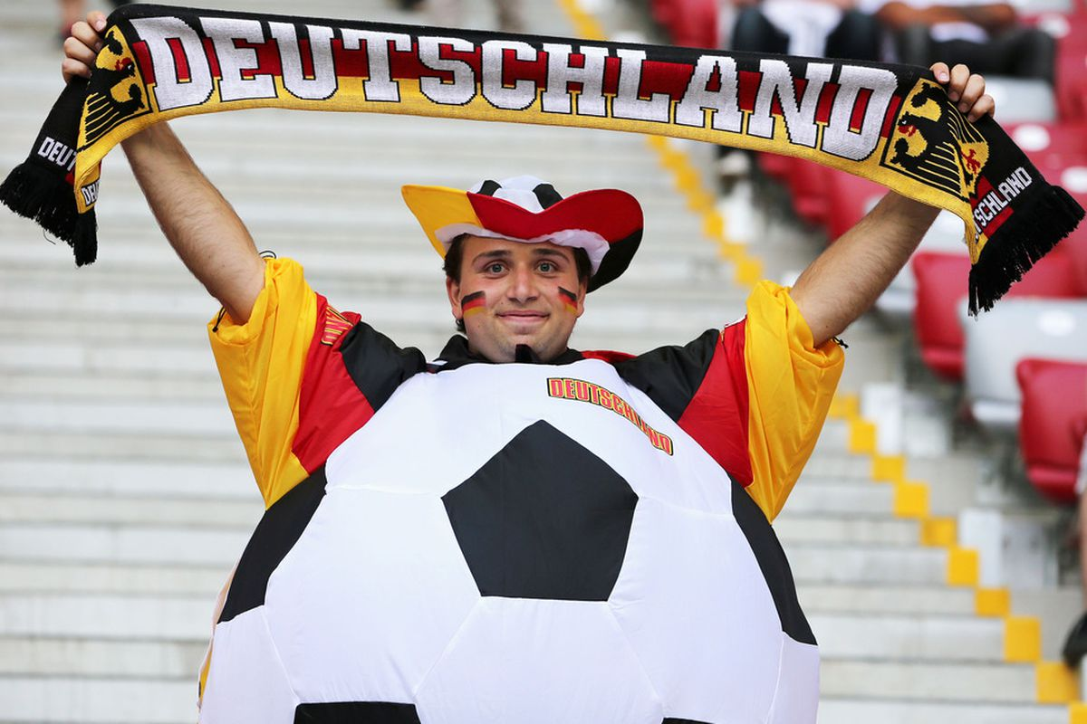 WARSAW, POLAND - JUNE 28:  A Germany fan enjoys the atmosphere ahead of the UEFA EURO 2012 semi final match between Germany and Italy at National Stadium on June 28, 2012 in Warsaw, Poland.  (Photo by Alex Grimm/Getty Images)