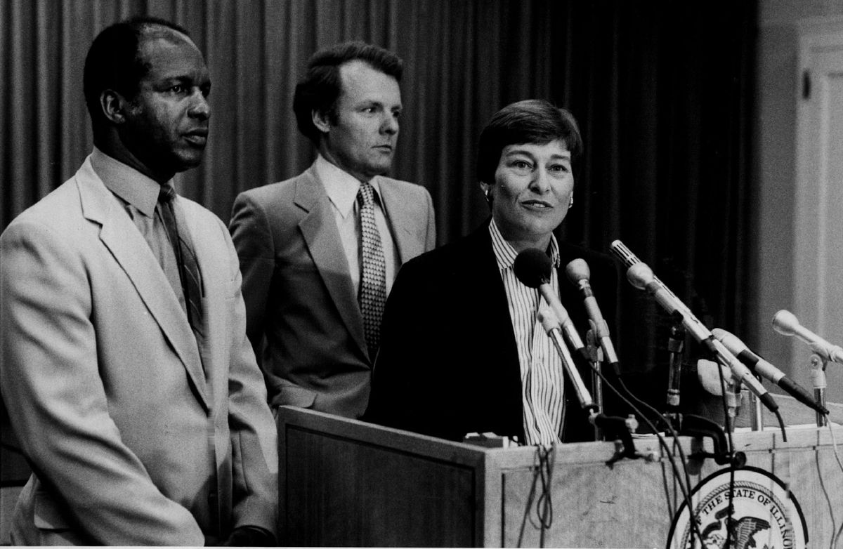 Barbara Flynn Currie speaks at a 1983 press conference alongside then state Rep. Jesse White and Speaker Michael Madigan.