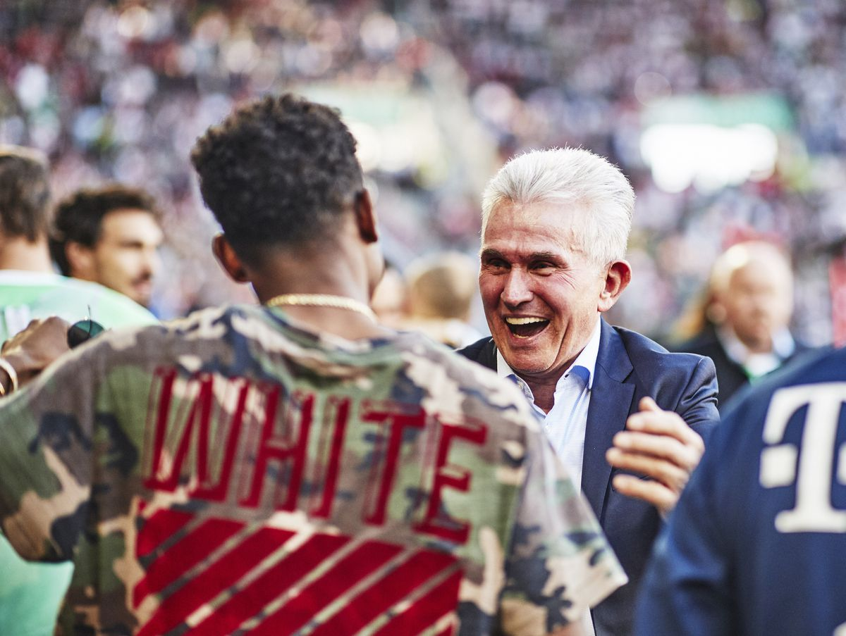 AUGSBURG, GERMANY - APRIL 07: Jupp Heynckes head coach of Bayern Munich celebrates with Arjen Robben of Bayern Munich after victory in the Bundesliga match between FC Augsburg and FC Bayern Muenchen at WWK-Arena on April 7, 2018 in Augsburg, Germany.