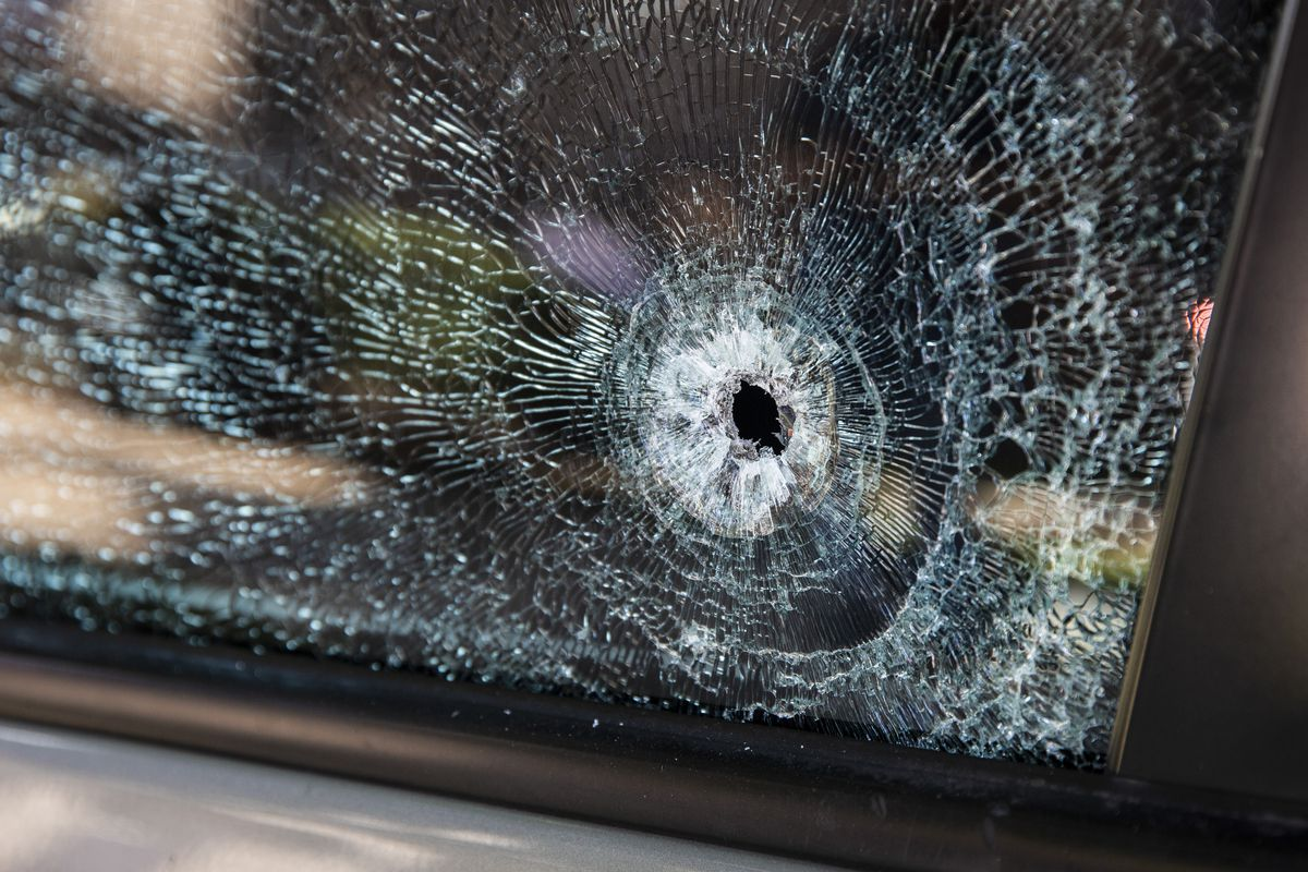 A car with bullet holes in two windows in the 600 block of West 61st Street, less than 24 hours after a 4-year-old girl was wounded on the Englewood block on the South Side,