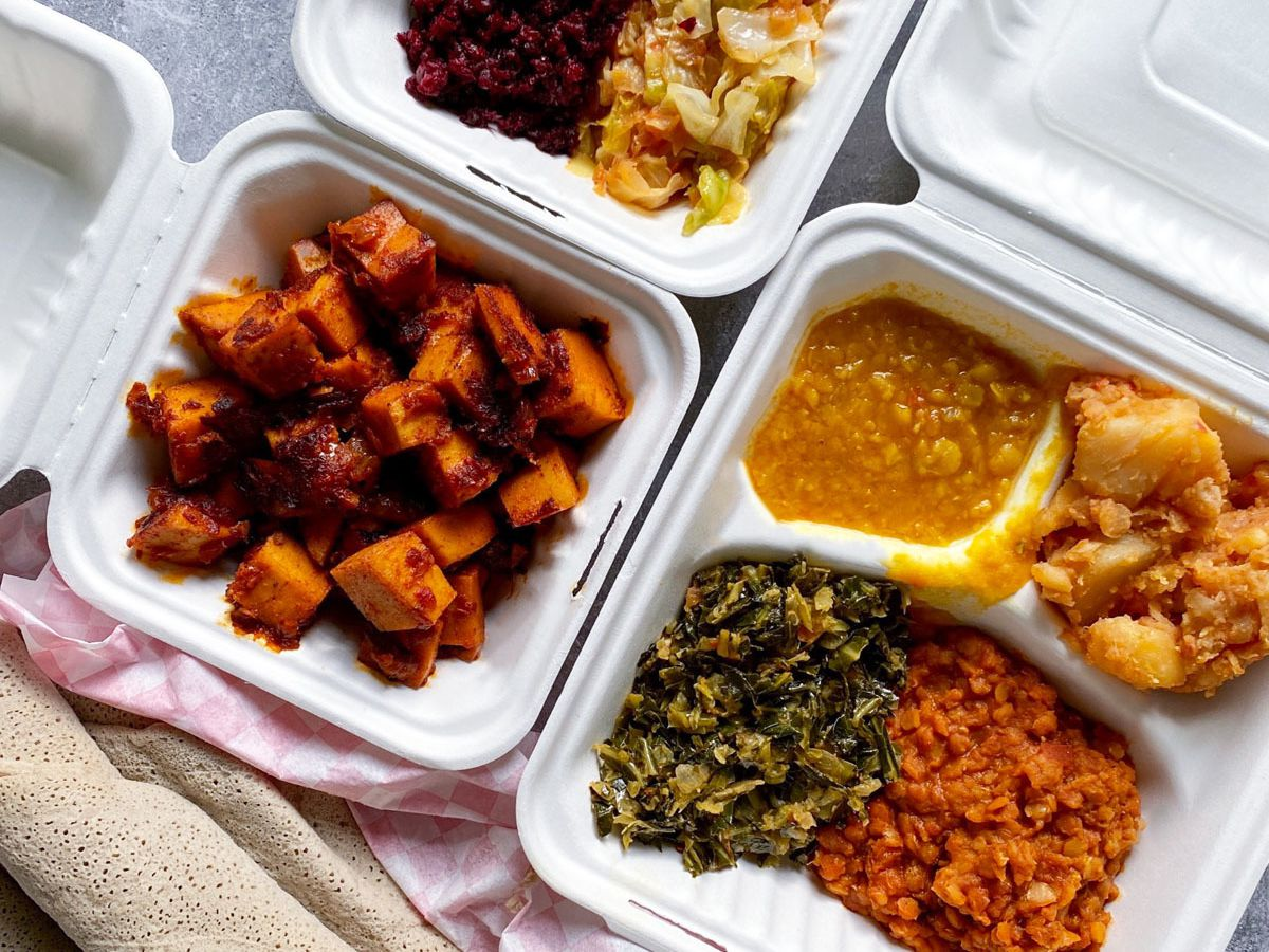 A spread of Ethiopian vegetable dishes, vegan tibs, and injera flatbread from Little Ethiopia Eatery
