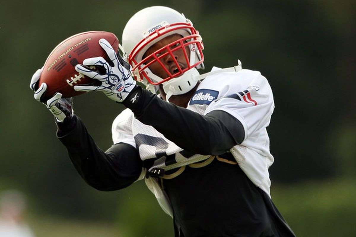 FOXBORO MA - AUGUST 02:  Torry Holt #84 of the New England Patriots catches a pass during training camp on August 2 2010 at Gillette Stadium in Foxboro Massachusetts.  (Photo by Elsa/Getty Images)