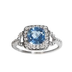 """14K white gold diamond halo ring with a 1/4ct. of round diamonds surrounding a 1.65ct. cushion cut blue topaz, $995 at <a href=""""http://www.safianrudolph.com/"""">Safian & Rudolph</a>."""