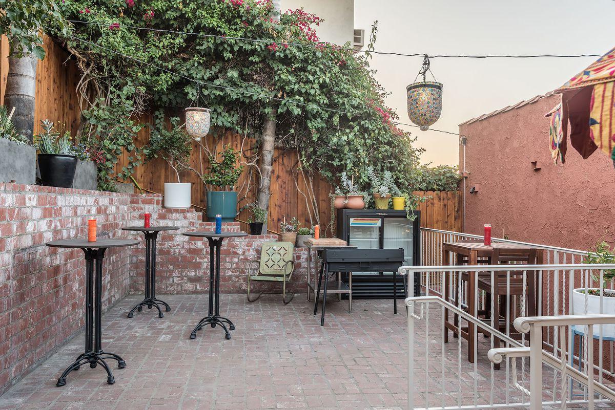 High tables, brick patio in Echo Park's Bar Flores.