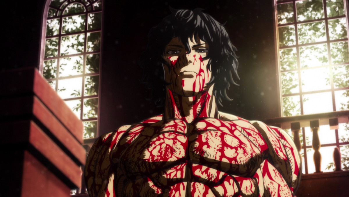 Ashura, a man with dark, curly shoulder-length hair stands in front of a window. He is wearing no shirt and blood — not his — is running down his muscles in rivulets.