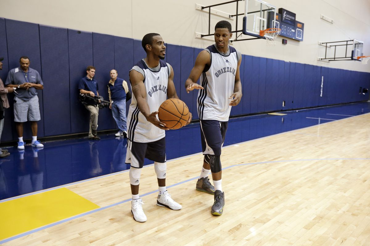 Memphis Grizzlies guard Mike Conley, left, and forward Rudy Gay, right, vie for the ball during NBA basketball training camp in 2012 in Memphis, Tennessee.