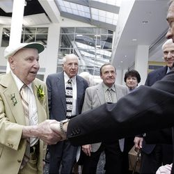 100-year-old Century Club centenarian Frank Bond of West Bountiful, left, talks with Gov. Gary Herbert  during a celebration in Salt Lake City on Friday.