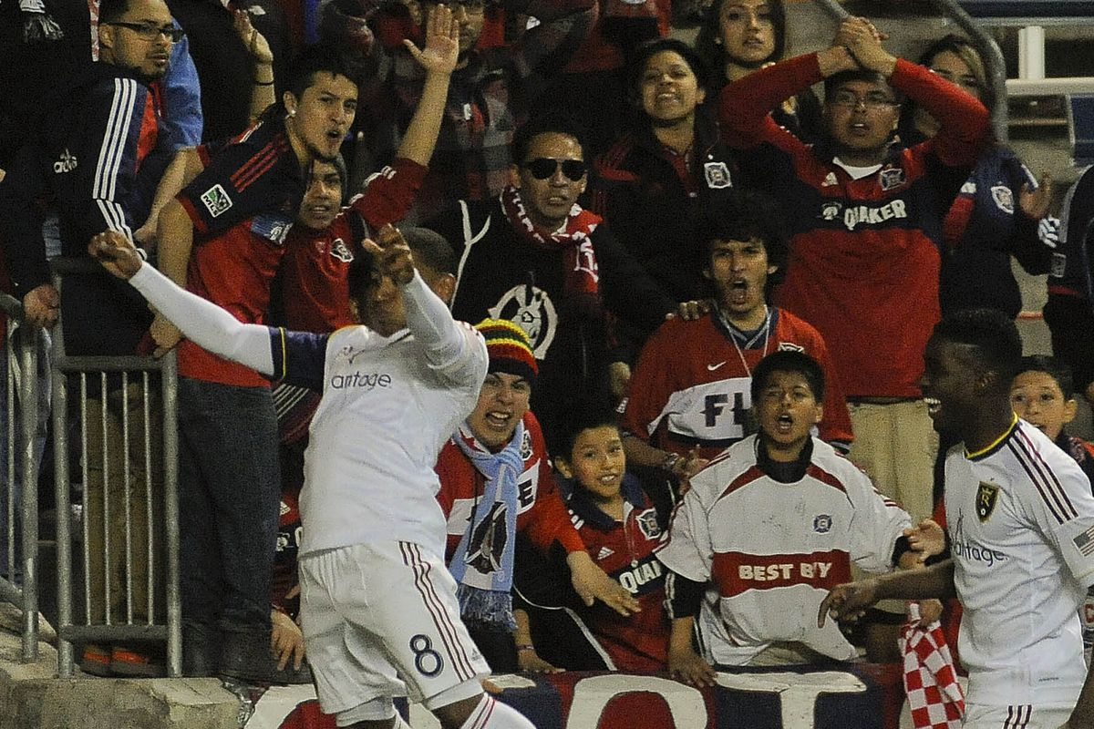 Joao Plata (L) and Olmes Garcia celebrate the winning goal in last year's Fire-RSL match in front of a despairing Sector Latino.