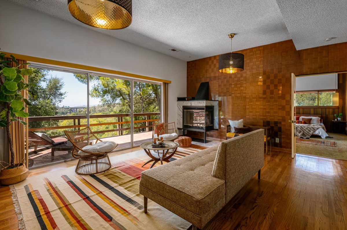 Room with a fireplace and large sliding glass doors.