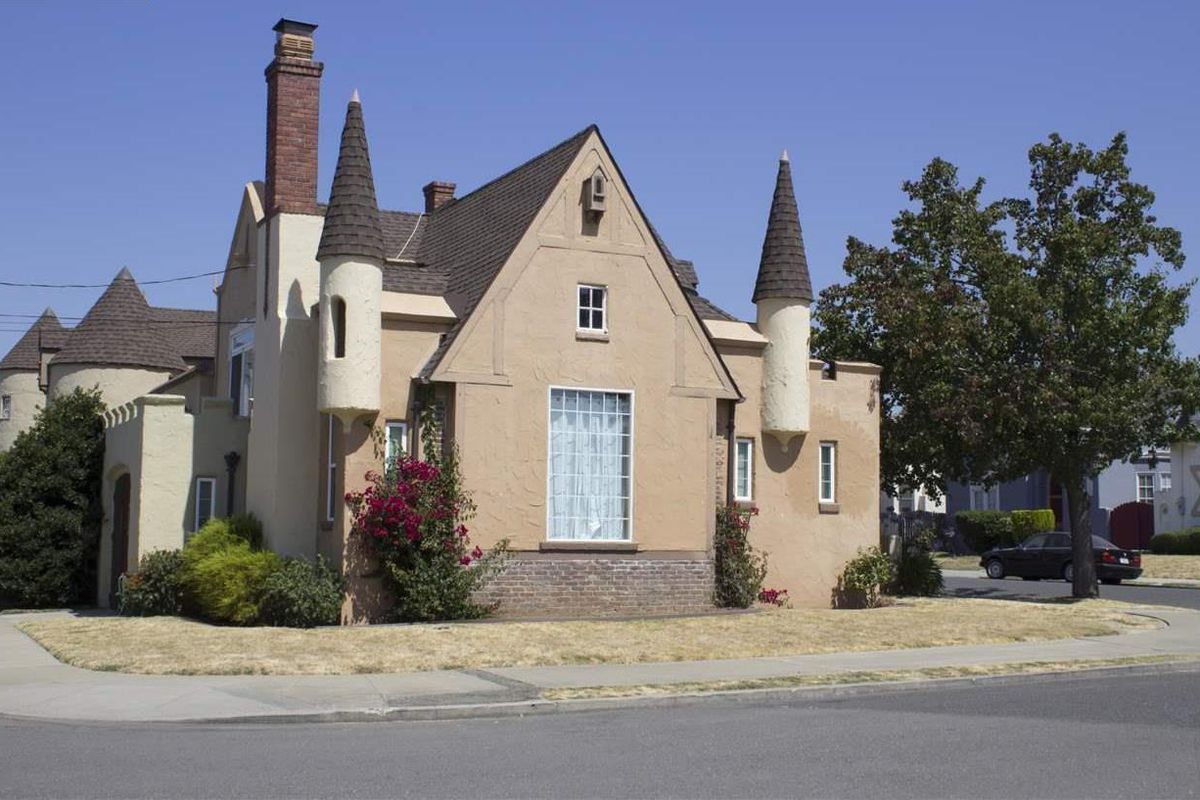 A faux-castle condo building in Oakland, with turrets and towers.