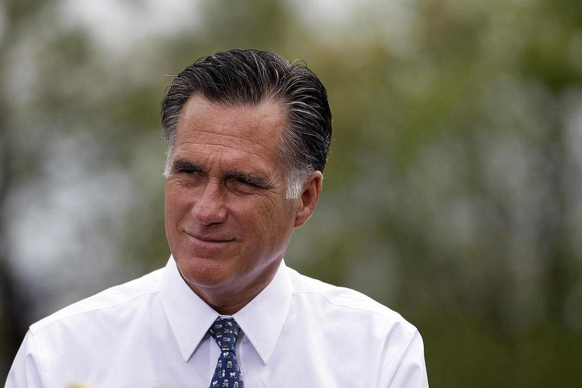 FILE - In this April 17, 2012, file photo Republican presidential candidate, former Massachusetts Gov. Mitt Romney,listens to Pittsburgh area residents in Bethel Park, Pa., during a campaign stop. Government spending differences are among the starkest bet