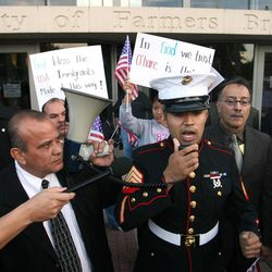 FILE - In this Nov. 13, 2006 file photo, former Marine Sgt. Salvadaor Parada, right, speaks to protesters during a rally outside city hall in Farmers Branch, Texas.  A federal appeals court will review Farmers Branch's ordinance, which allows the city building inspector to evict any illegal immigrant renters.