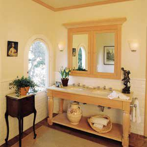 <p>CUSTOM VANITY: Adapting a piece of furniture like a farmhouse table or sideboard to serve as a vanity can have its limitations. In this case, the two undermount sinks are set close together, there isn't a lot of countertop area and the level of the lavs is fixed by the height of the table. Still, a one-of-a-kind look like this can make an ordinary bathroom special.</p>