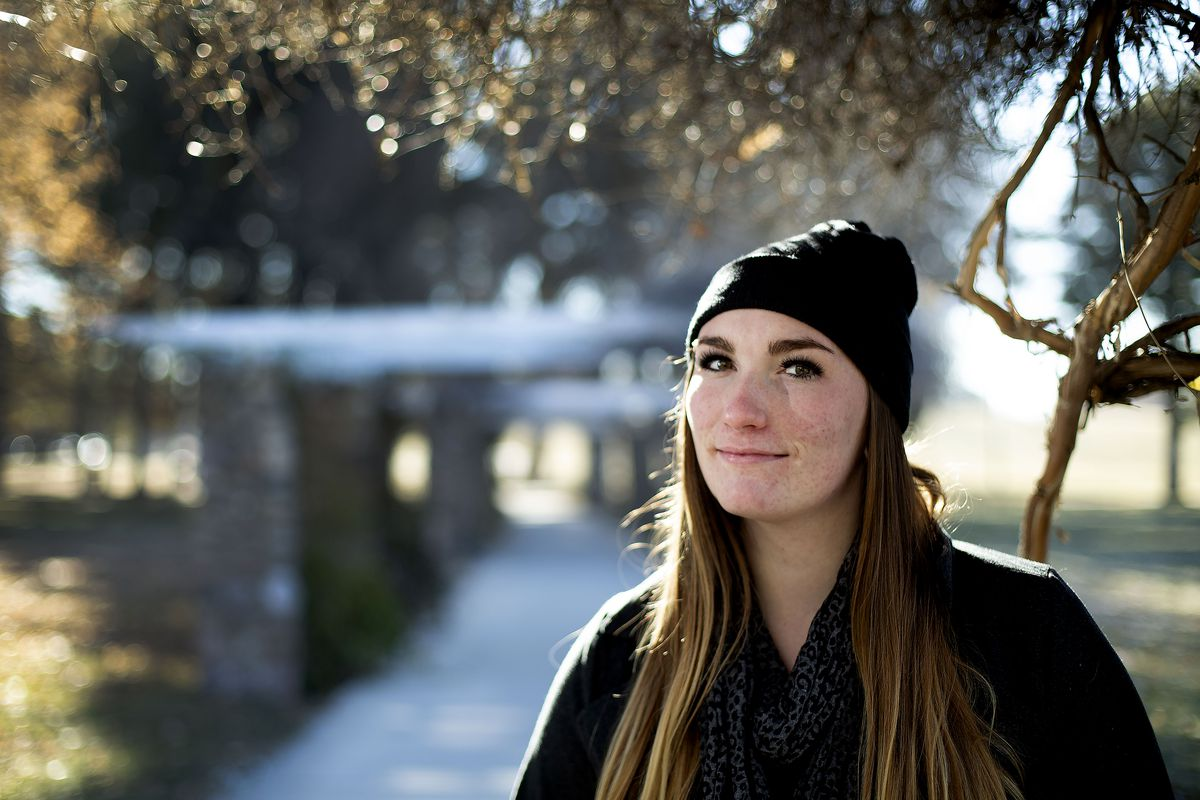 """Natalie Clark is photographed in Liberty Park in Salt Lake City on Tuesday, Dec. 17, 2019. Clark, 21, grew up living in and out of Utah's foster care system starting when was 3 years old until she """"aged out"""" at age 18."""