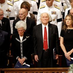 From left, astronaut Buzz Aldrin, Annie Glenn, astronaut and former Ohio Sen. John Glenn, and singer Diana Krall, stand during the opening processional at the Washington National Cathedral in Washington, Thursday, Sept. 13, 2012,  during a national memorial service for the first man to walk on the moon, Neil Armstrong.