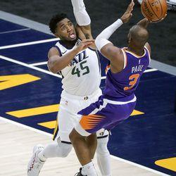 Utah Jazz guard Donovan Mitchell (45) guards Phoenix Suns guard Chris Paul (3) as he shoots during a preseason NBA game at the Vivint Smart Home Arena in Salt Lake City on Monday, Dec. 14, 2020. The Jazz beat the Suns 111-92.