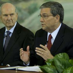 Elder Russell M. Nelson, left, of the Quorum of the Twelve, listens as Elder David F. Evans answers a question about the change in missionary ages soon after it was announced last October.