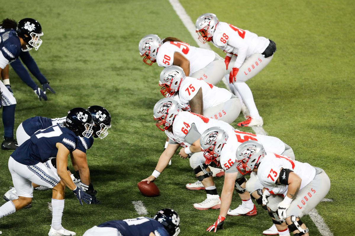 Utah State Aggies and New Mexico Lobos players line up on the line of scrimmage during an NCAA football game at Maverik Stadium in Logan on Thursday, Nov. 26, 2020.