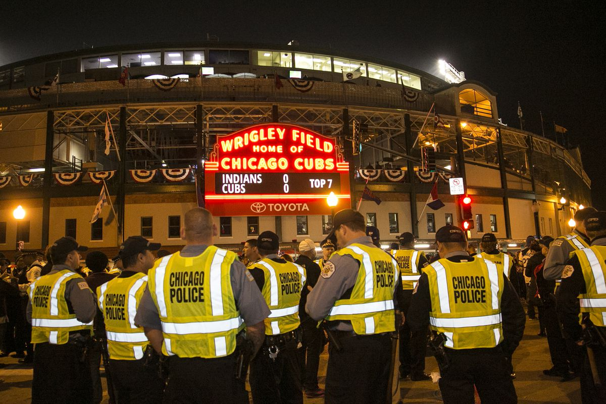 Chicago Police stand guard outside Wrigley Field while the Chicago Cubs take on the Cleveland Indians during the World Series Friday night. | Ashlee Rezin/Sun-Times