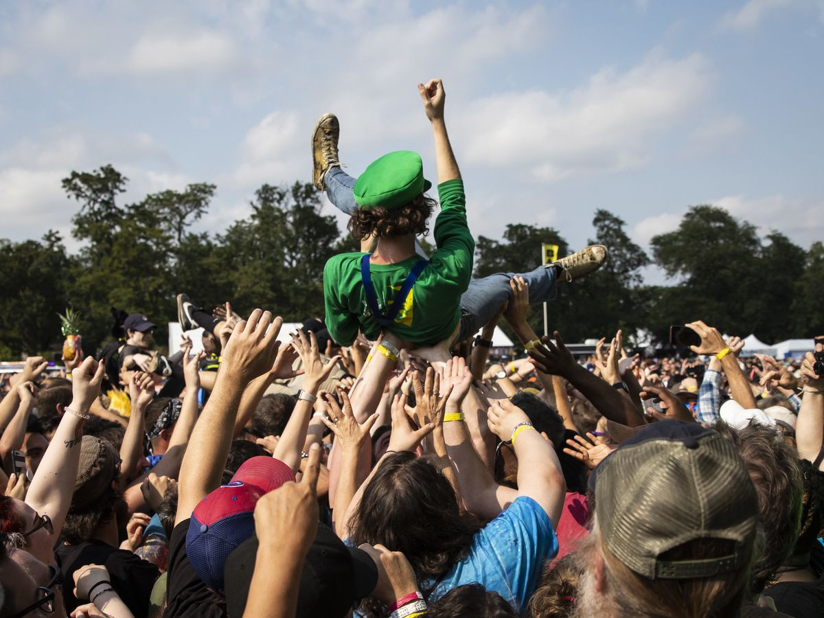Fans crowd surf as the Village People perform on day three of Riot Fest in Douglas Park, Sunday afternoon, Sept. 15, 2019.