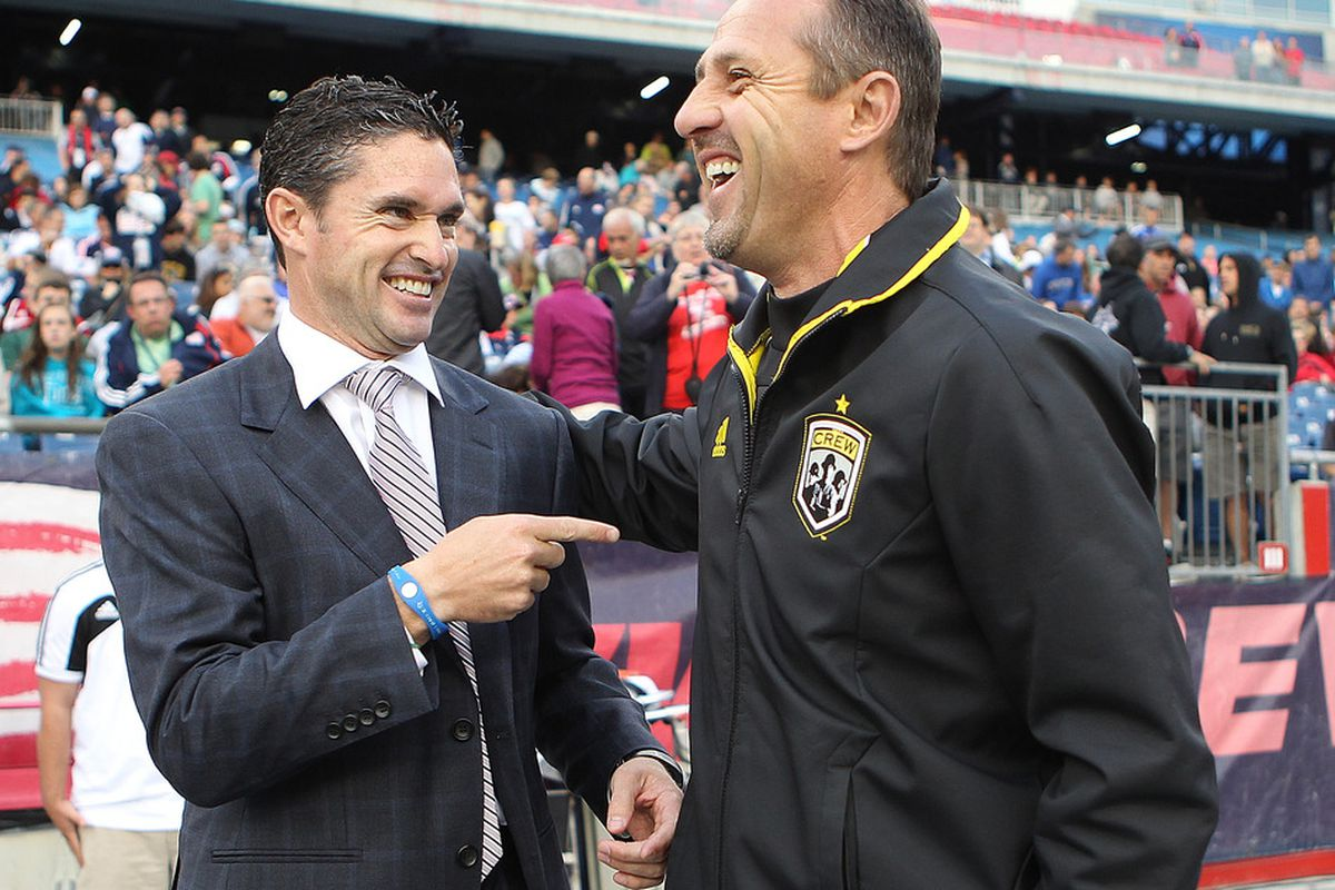 FOXBORO, MA - JUNE 16:  Jay Heaps, the coach of the New England Revolution, interacts with Robert Warzycha, coach of the Columbus Crew, at Gillette Stadium on June 16, 2012 in Foxboro, Massachusetts. (Photo by Jim Rogash/Getty Images)