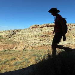 Interior Secretary Sally Jewell hikes in Butler Wash near Bluff in southern Utah on Saturday, July 16, 2016. During her trip to the region, she said she was shocked by the lack of protection for Native American cultural sites. Today, President Barack Obama declared the Bears Ears National Monument in southeast Utah.