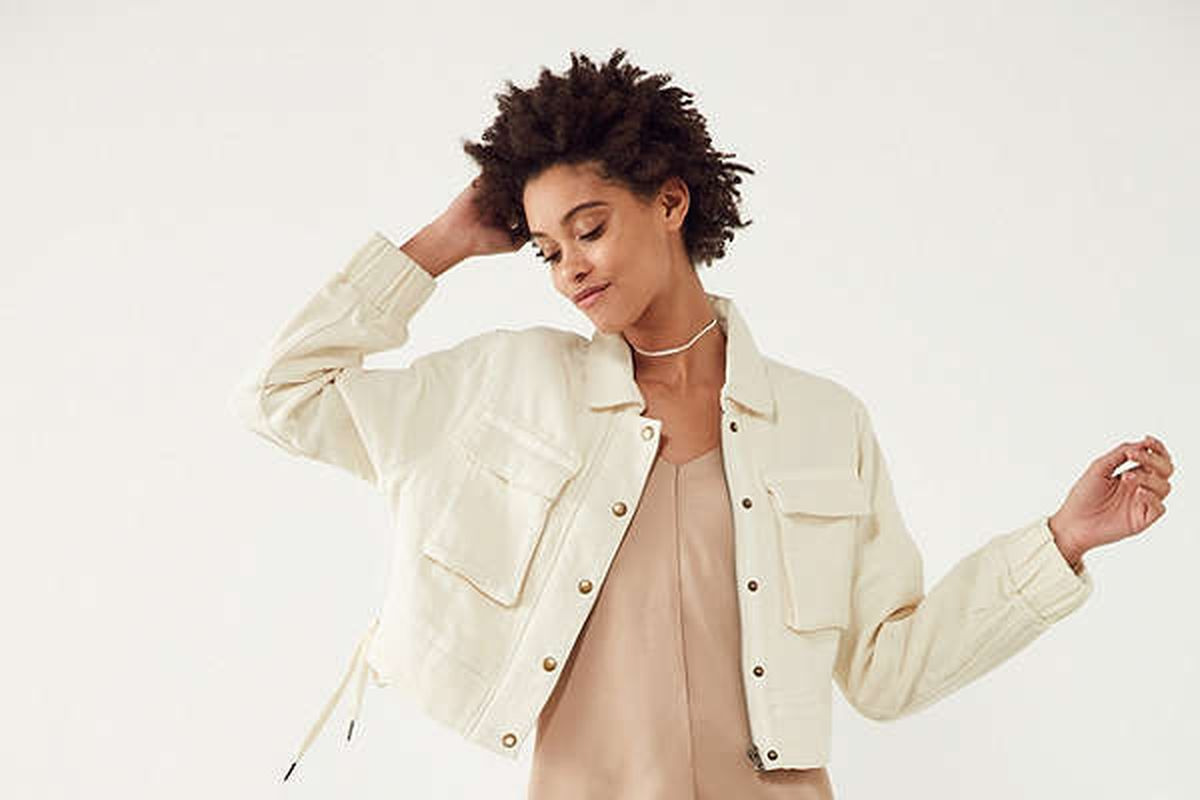 A model in a white jacket.