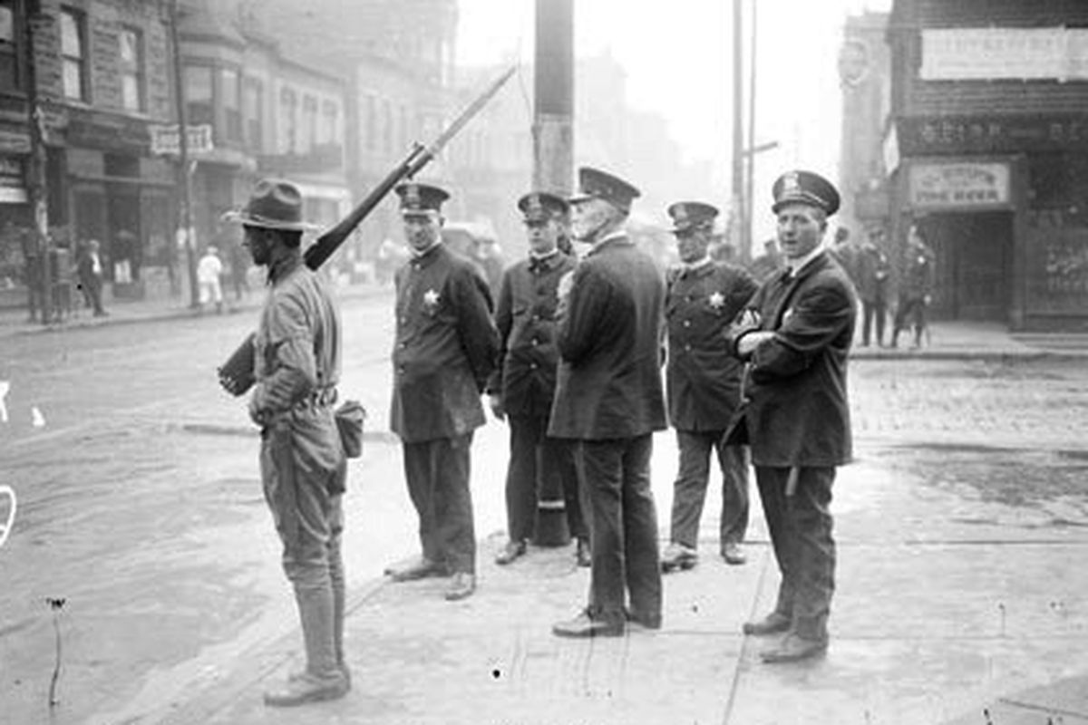 Police and Army soldiers guard Chicago streets during the 1919 riots that followed the killing of Eugene Williams. His grave finally receives a marker this Saturday.