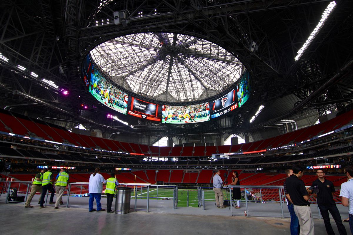 Looking up at the oculus of Mercedes-Benz Stadium.