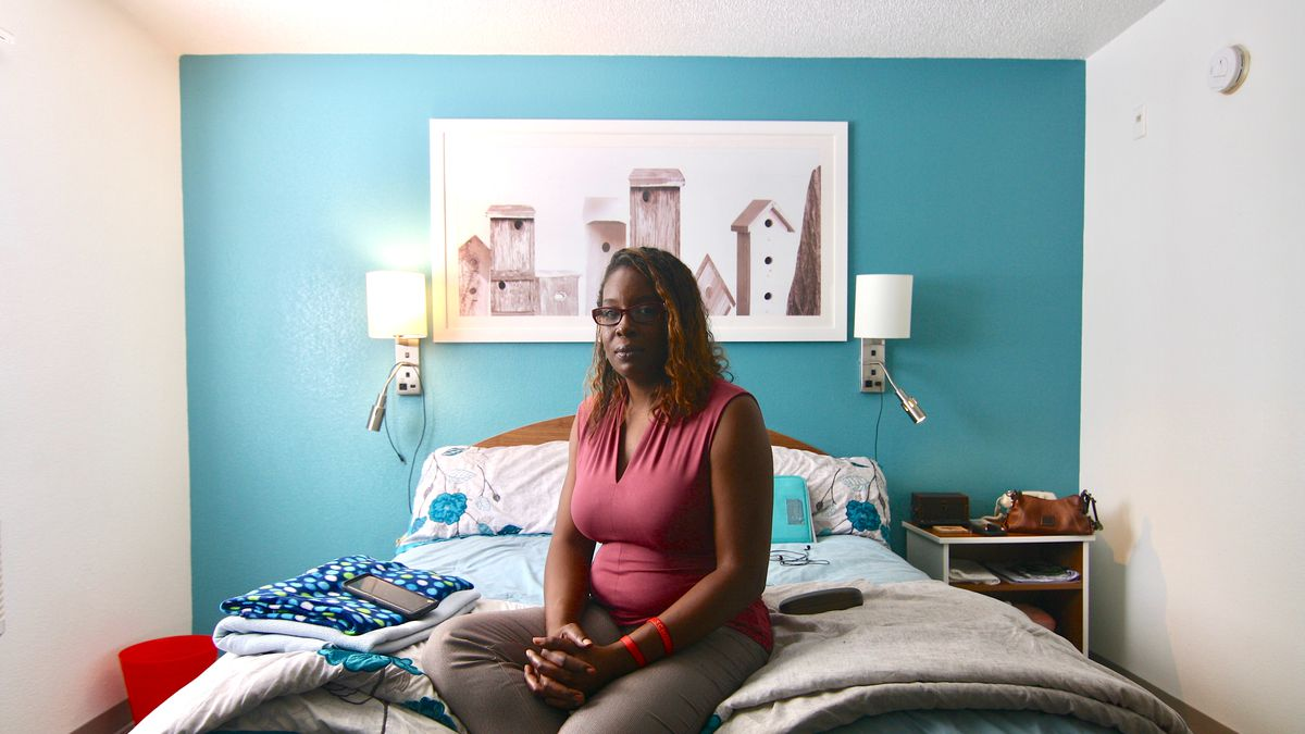 Keaton in the extended-stay hotel room she's shared with her two sons since late August.