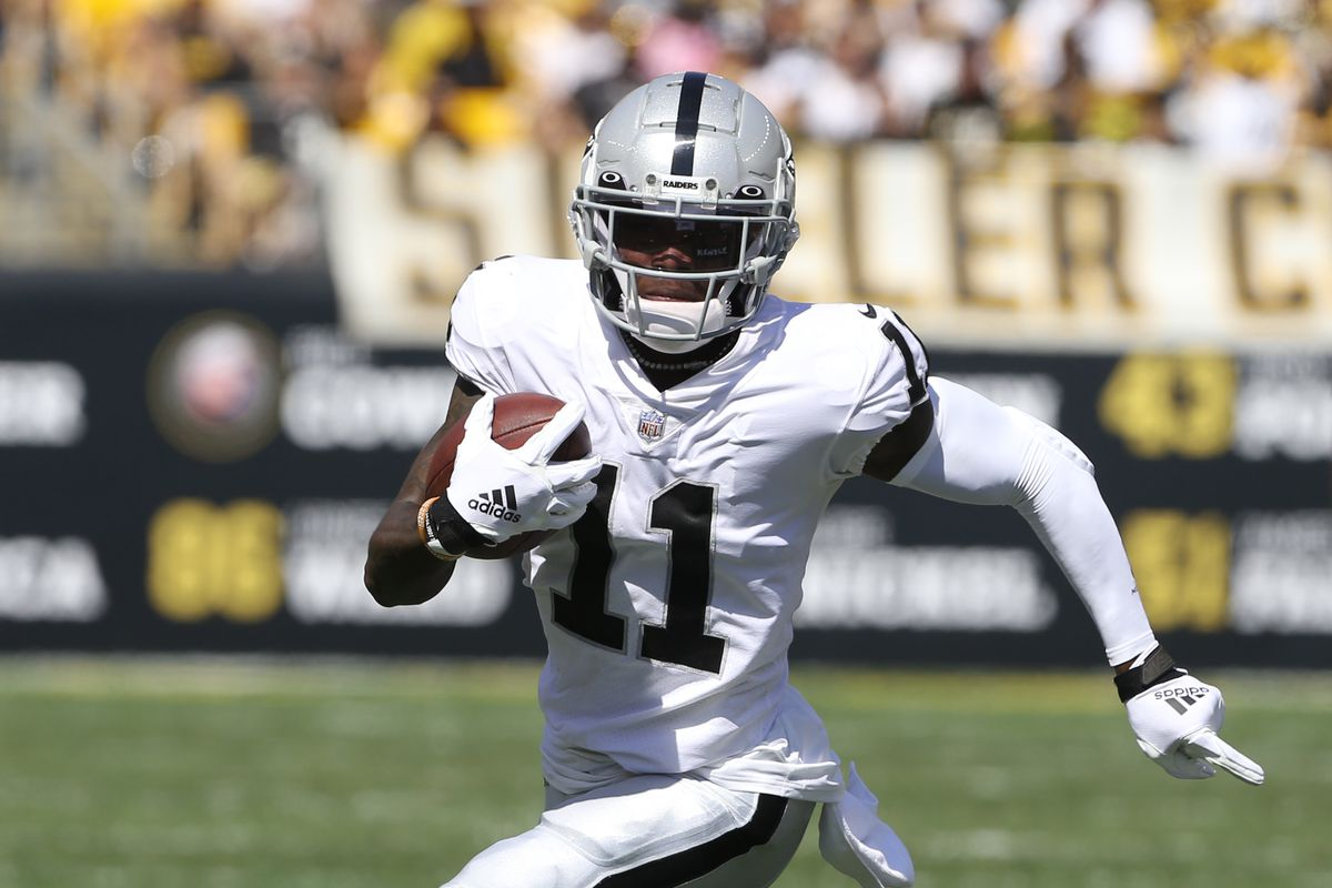 Las Vegas Raiders wide receiver Henry Ruggs III (11) runs after a catch against the Pittsburgh Steelers during the second quarter at Heinz Field.