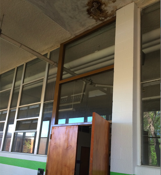 Water damage from roof leak at the cafeteria entrance at Libertas School of Memphis. (Photo by Laura Faith Kebede)