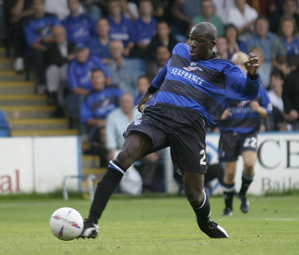 Nyron Nosworthy of Gillingham scores the fourth goal