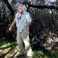 Ed Snoddy searches camps near the Jordan River for residents in need of health care and food in West Valley City on Monday, Nov. 7, 2016.