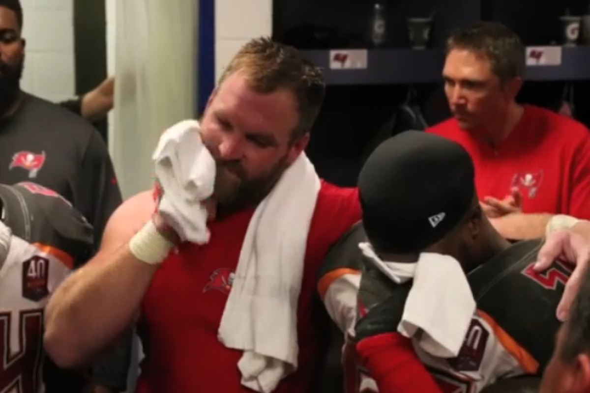 Logan Mankins offers support to Kwon Alexander after the Buccaneers 23-20 overtime victory against the Falcons.