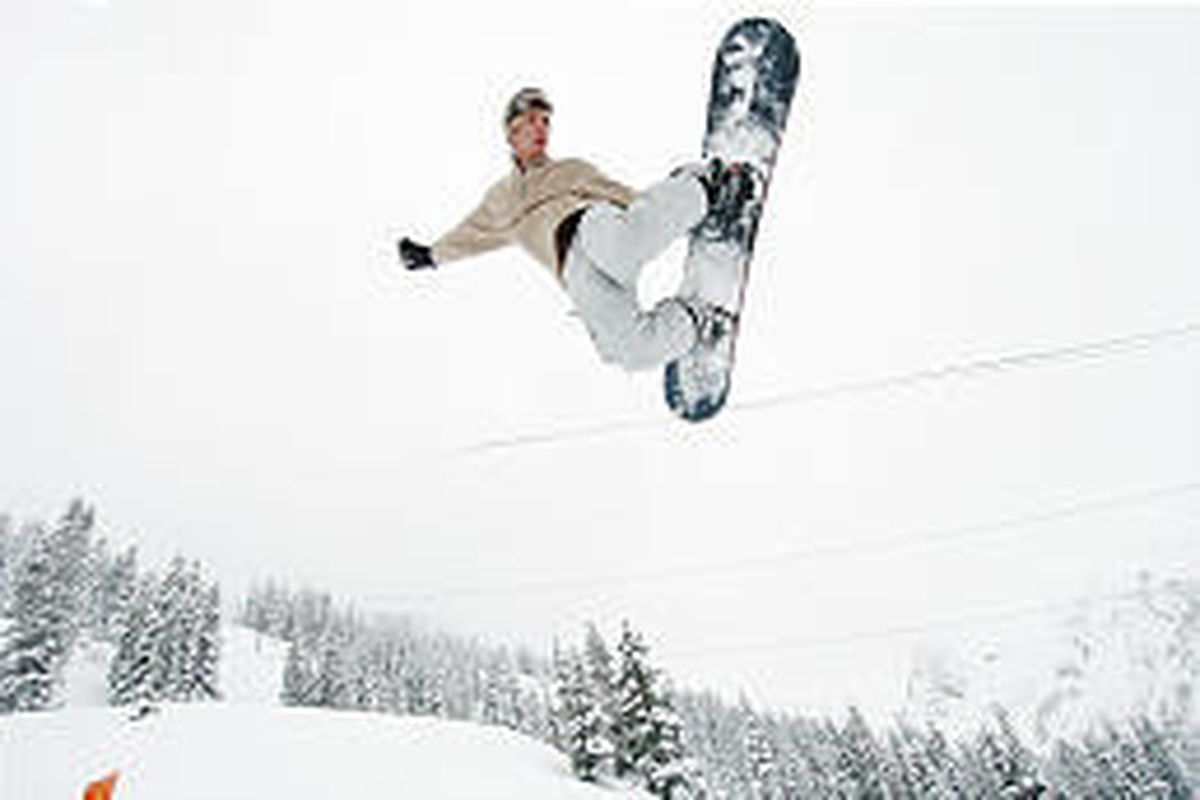 Fresh snow lets Courtney Lund board as well as hike in Little Cottonwood Canyon.
