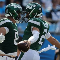 New York Jets quarterback Zach Wilson celebrates after scoring a 2-point conversion with Tyler Kroft against the Carolina Panthers during the second half of an NFL football game Sunday, Sept. 12, 2021, in Charlotte, N.C.