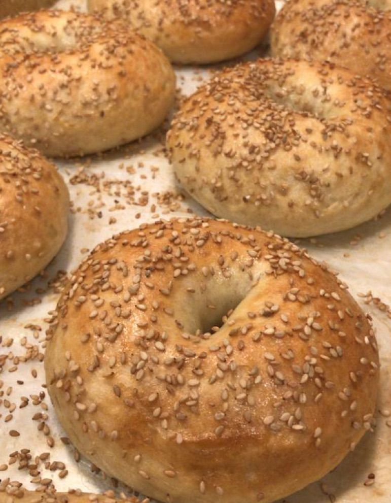 Rows of sesame seed-topped bagels.
