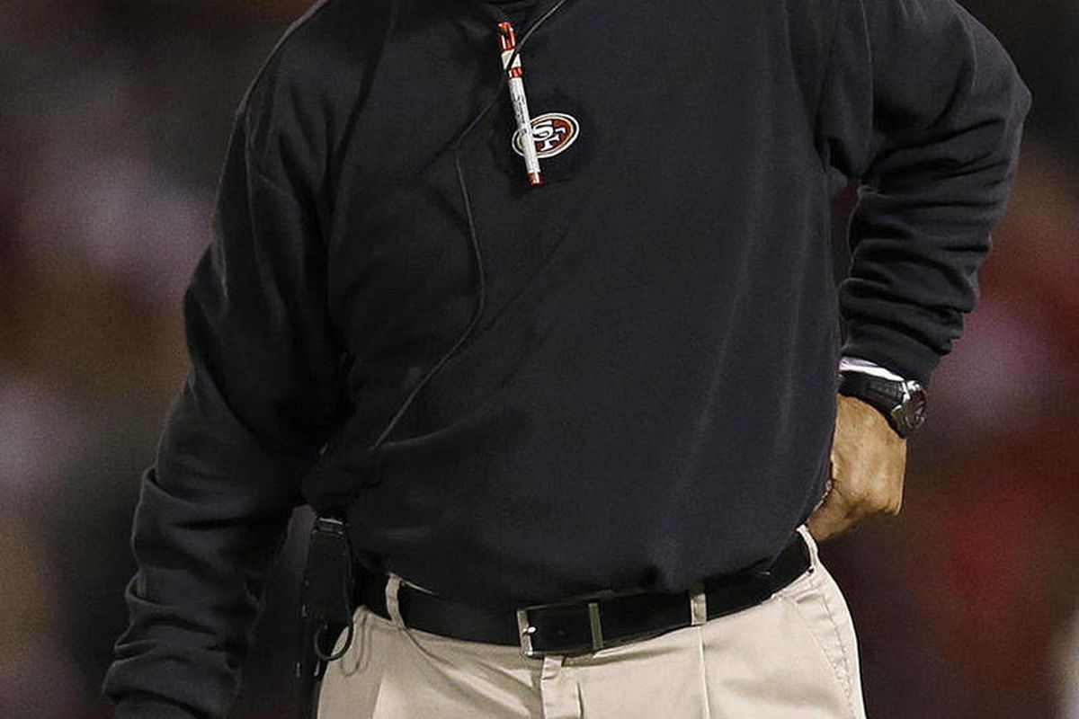 San Francisco 49ers head coach Jim Harbaugh watches from the sidelines during the first half of an NFL preseason football game against the San Diego Chargers in San Francisco, Thursday, Aug. 30, 2012.