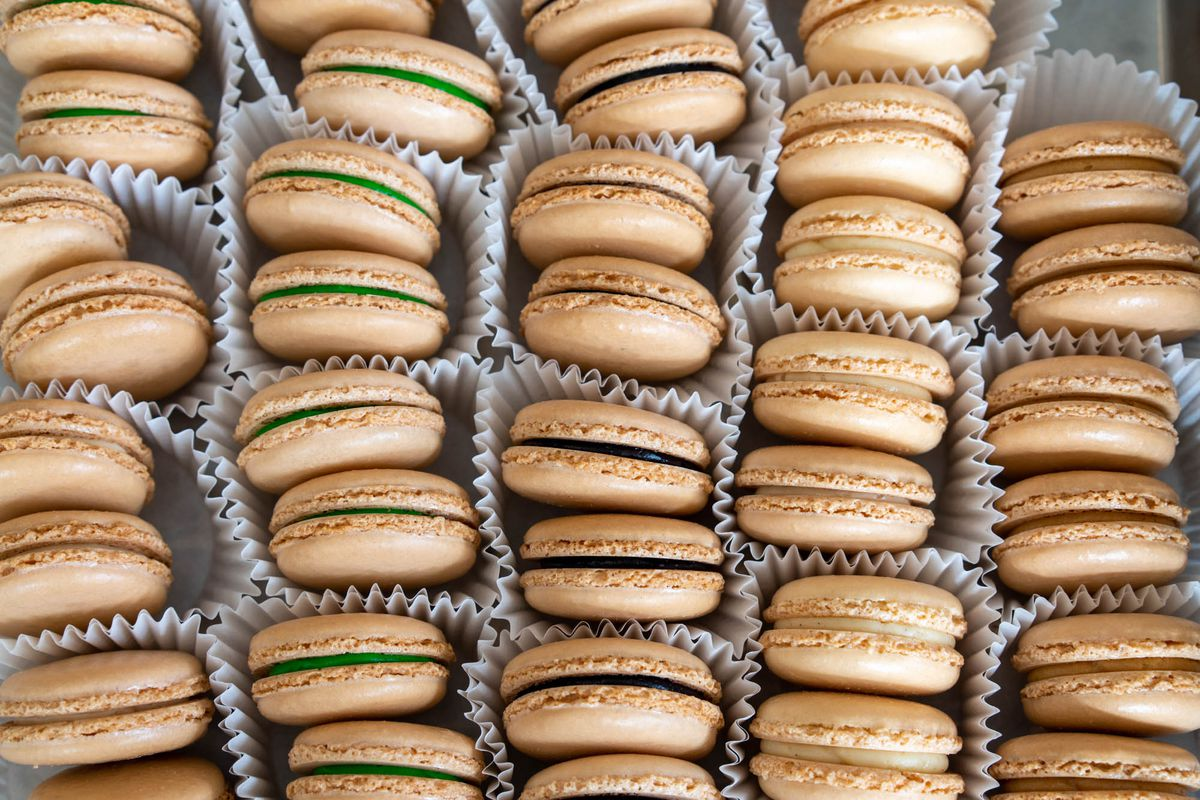 A close-up shot of macarons set in paper wrappers