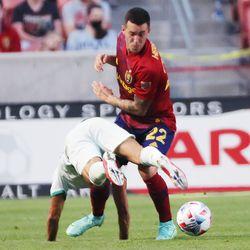 Real Salt Lake defender Aaron Herrera (22) tosses aside Colorado Rapids forward Nicolas Mezquida (20) at Rio Tinto Stadium in Sandy on Saturday, July 24, 2021.