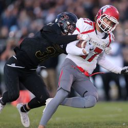 Lone Peak's Nate Ritchie tackles American Fork's Chase Roberts during a football game at Lone Peak High School in Alpine, on Friday, Sept. 22, 2017.