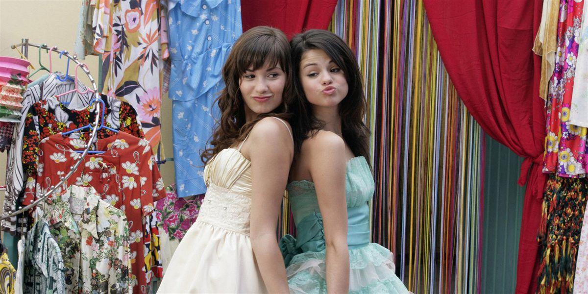 demi lovato and selena gomez back-to-back in pretty dresses, smiling and bonding