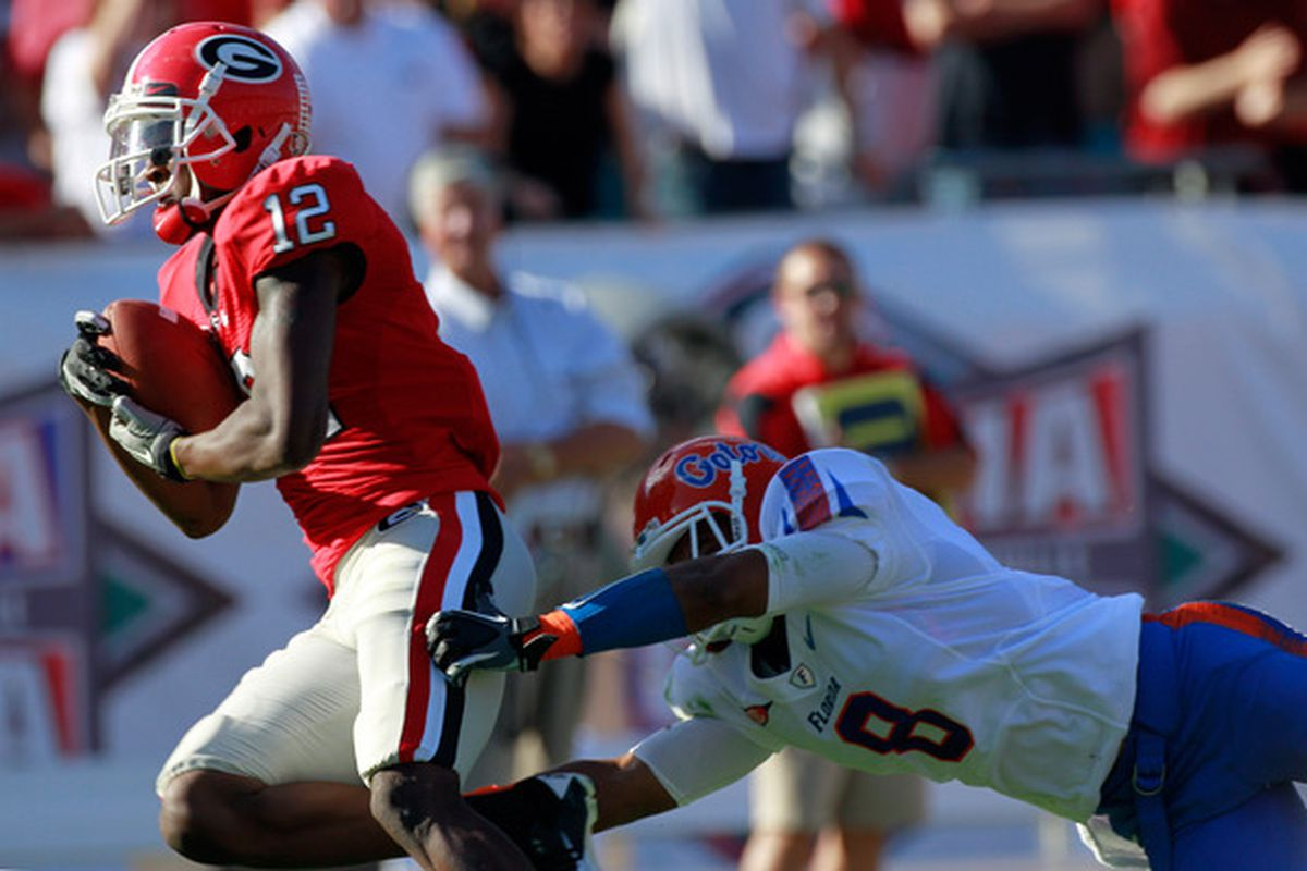 JACKSONVILLE FL - OCTOBER 30:  Jeremy Brown #8 of the Florida Gators attempts to tackle Tavarres King #12 of the Georgia Bulldogs during the game at EverBank Field on October 30 2010 in Jacksonville Florida.  (Photo by Sam Greenwood/Getty Images)