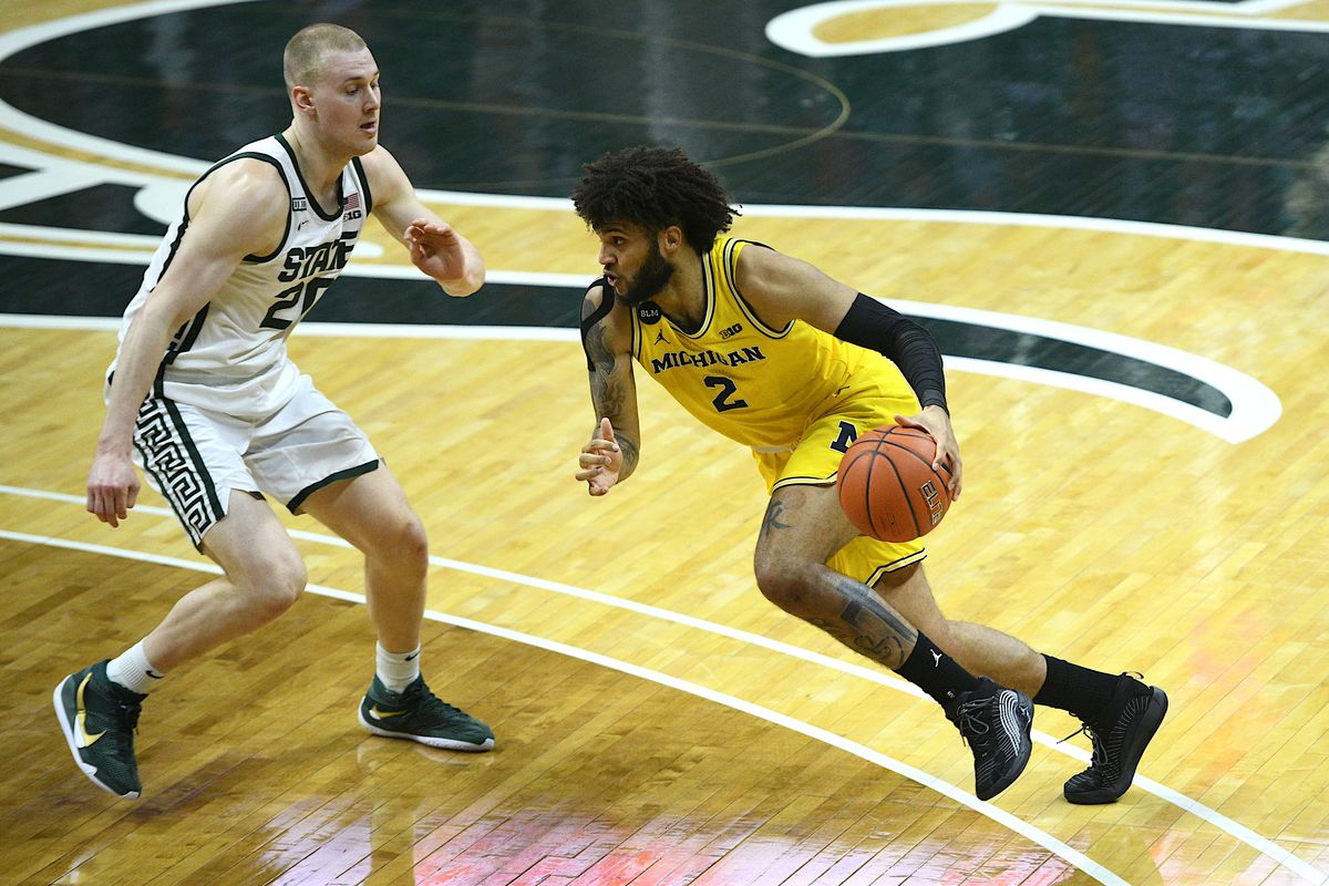 Michigan Wolverines forward Isaiah Livers drives to the basket as Michigan State Spartans forward Joey Hauser defends during the first half at Jack Breslin Student Events Center.