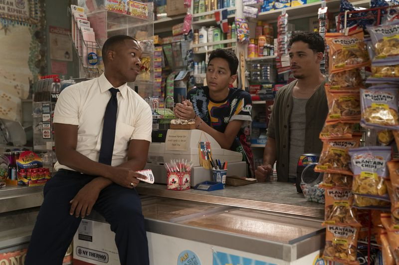 Three young men in a bodega.