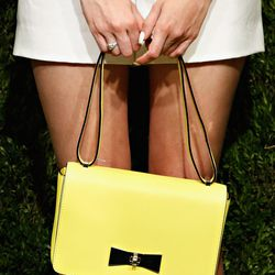 A sunny yellow bag with minimal hardware.